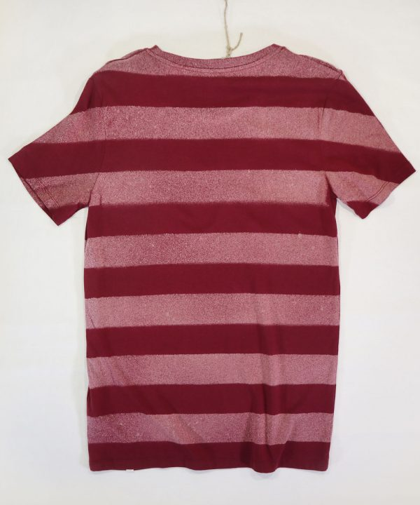 Back of Stripes Danga model on burgundy organic cotton unisex tshirt
